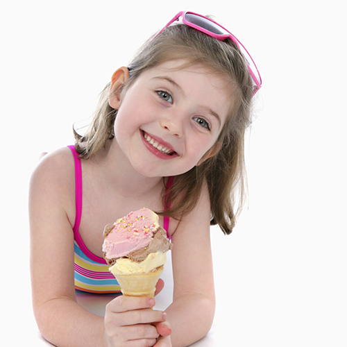 Litle girl holding an ice cream cone