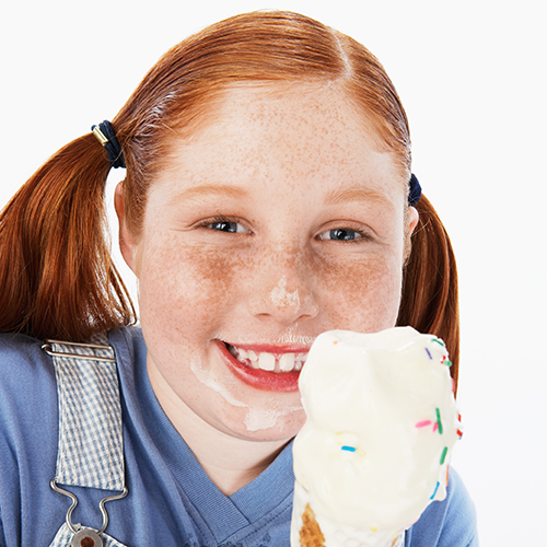 Red haired girl with an ice cream cone.
